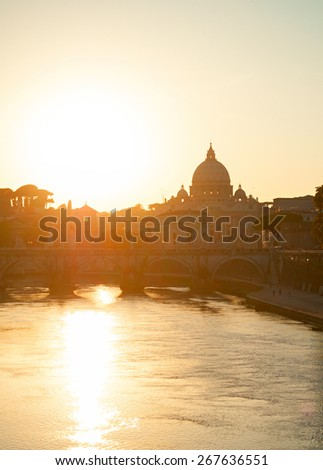 Sunset view of Tiber river and St. Peter's cathedral. Vatican, Rome