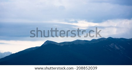Sunset view on mountain and cloudy sky in Crimea