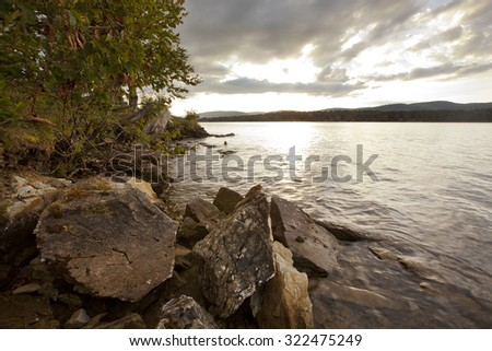 Sunset view on Onota Lake in the Berkshire Mountains of Western Massachusetts. - stock photo