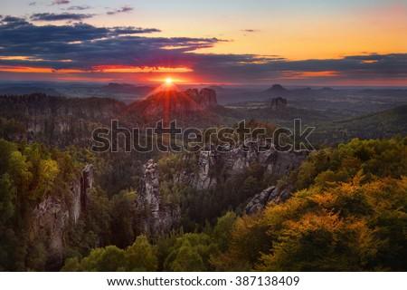 sunset view on Schrammsteine from Carolafelsen, Saxon Switzerland - stock photo