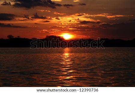 Sunset View over the Laguna, National Park Cuyabeno. Ecuador - stock photo