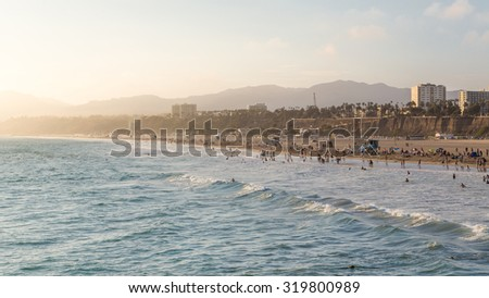 Sunset view with silky sky and golden beach of California, Santa Monica. A summer day  - stock photo