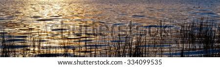 Sunset Water Reflection - stock photo