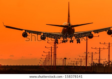 Sunset when a commercial jet lands at Airport