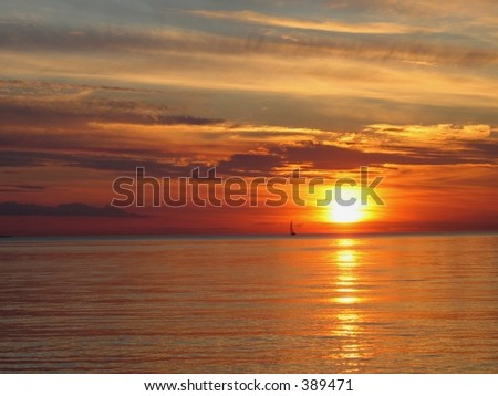 Sunset with a boat - stock photo