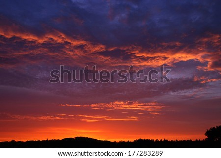 Sunset with alpenglow horizontally - stock photo