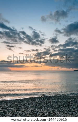 Sunset with beautiful cloudscape on background