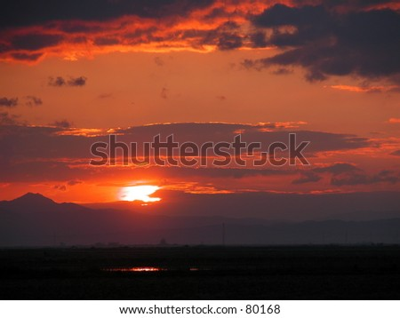 Sunset with beautiful red sky - stock photo