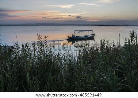 sunset with boat in the Albufera of Valencia, Spain