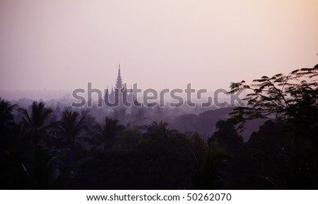 Sunset with buddhist temple in Bago, myanmar, burma - stock photo