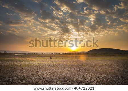 Sunset with crack soil - stock photo