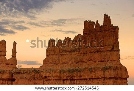 Sunset with full moon over Bryce Canyon, Utah, USA. - stock photo
