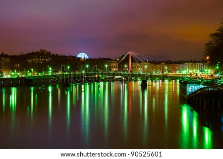 Sunset with green city illumination in Lyon, France