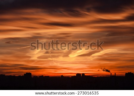 Sunset with industrial skyline, fire sky.