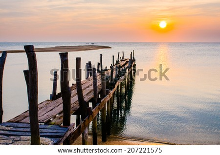 Sunset with Old ruin of pier. - stock photo