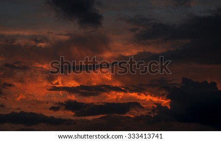 Sunset with orange and yellow clouds in the sky