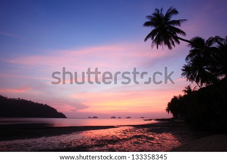 Sunset with palm tree silhouette in Thailand, Koh Samui - stock photo