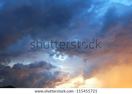 Sunset with rain clouds in Bangkok, Thailand. - stock photo