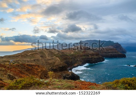 Sunset with rocks and cliffs and dramatic sky with clouds at Ponta de Sao Lourenco, Madeira island, Portugal - stock photo