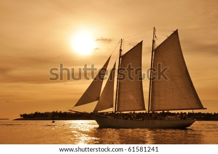 Sunset with sailboat in Key West - stock photo