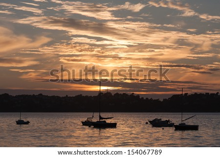 Sunset with ships at coast of Brittany