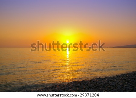 Sunset with smooth rocks in the foreground