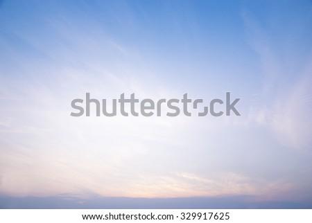 Sunset with soft blue sky background  - stock photo