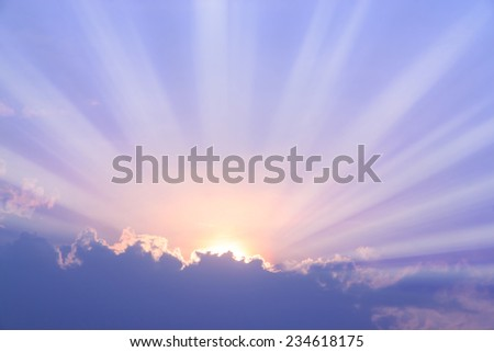 Sunset with sun rays in purple filter - stock photo