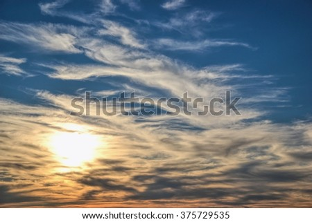 Sunset with sun rays, Sun Rocketing to the Sky, Clouds and sky with sun, Beautiful blue sky with sunbeams and clouds., the sun's rays illuminate the sky above the horizon, blue sky background clouds - stock photo