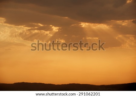 sunset with sunrays in the north of Portugal - stock photo