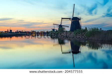 Sunset with the dutch windmills at Kinderdijk, an UNESCO world heritage site. - stock photo