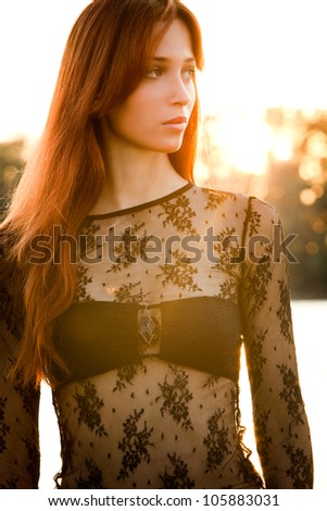 sunset woman portrait at the river - stock photo