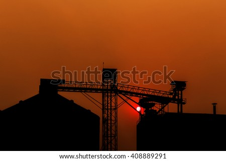 Sunsets behind the silos in April - stock photo