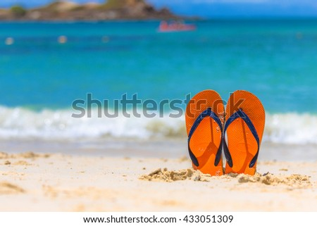 Sunshine clean beach and blue sea with sandal on summer,  relaxation concept - stock photo