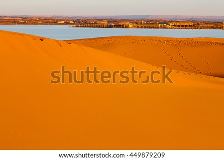 sunshine in the lake  desert of morocco sand and dune - stock photo
