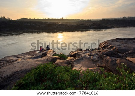 Sunshine on strong test cliff with people stay that. - stock photo