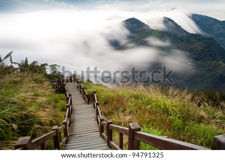 Sunshine with mountain , cloud and fog in the morning - stock photo