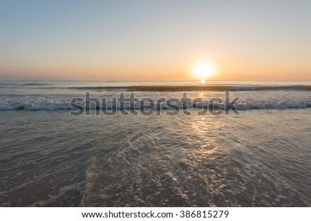 Sunshine with water splash at the tropical beach - stock photo