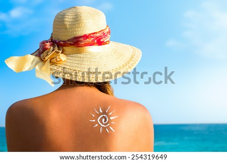 Suntan lotion woman with sunscreen solar cream over ocean background - stock photo