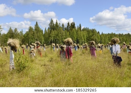 SUOMUSSALMI, FINLAND - JULY 26, 2012:Silent people is work of art by artist Reijo Kela. This work include about thousand scarecrow. Silent People moved to their present home in autumn of 1994.
