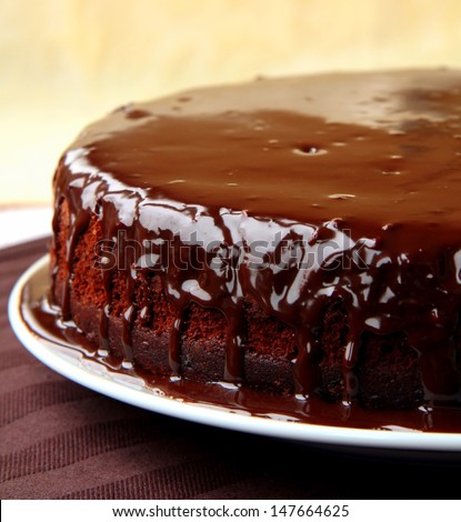 super chocolate cake with chocolate sauce - stock photo