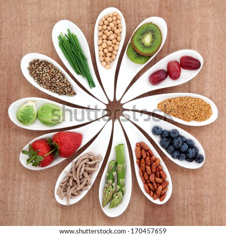 Super food health food selection in white bowls over papyrus background. - stock photo