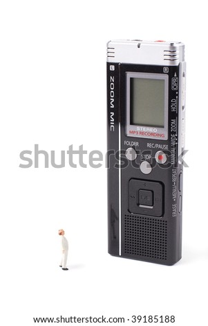 Super gadget - tiny man and huge voice recorder isolated - stock photo