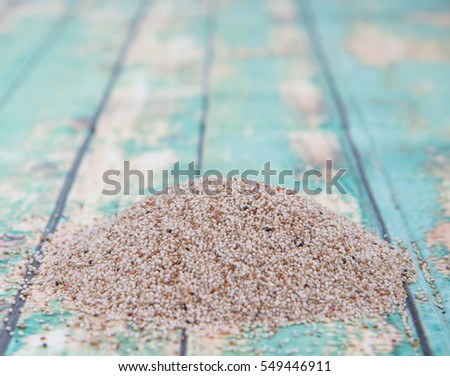 Super grain, white teff over wooden background
