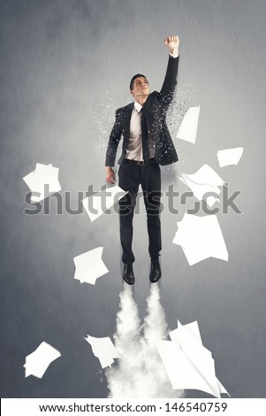 Super hero businessman flying out the office - stock photo
