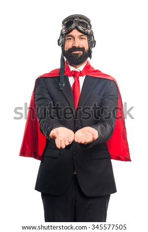 Super hero businessman holding something