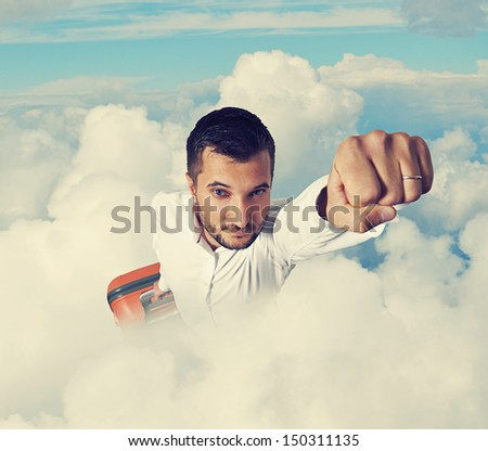 super hero businessman holding suitcase and flying through the clouds - stock photo
