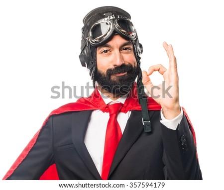 Super hero businessman making OK sign - stock photo