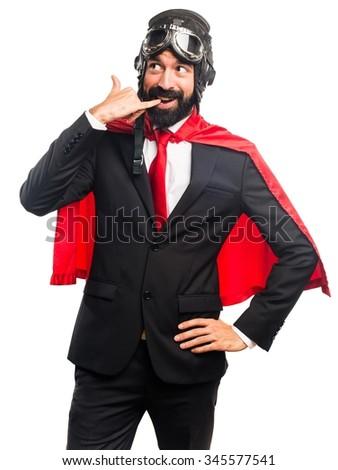 Super hero businessman making phone gesture - stock photo
