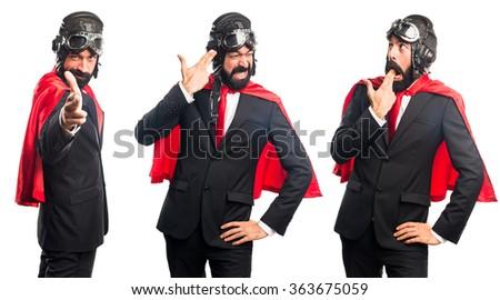 Super hero businessman making suicide gesture - stock photo